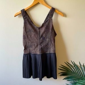 Lululemon peplum tank top, built in bra lining with pleats. Cut out in back.